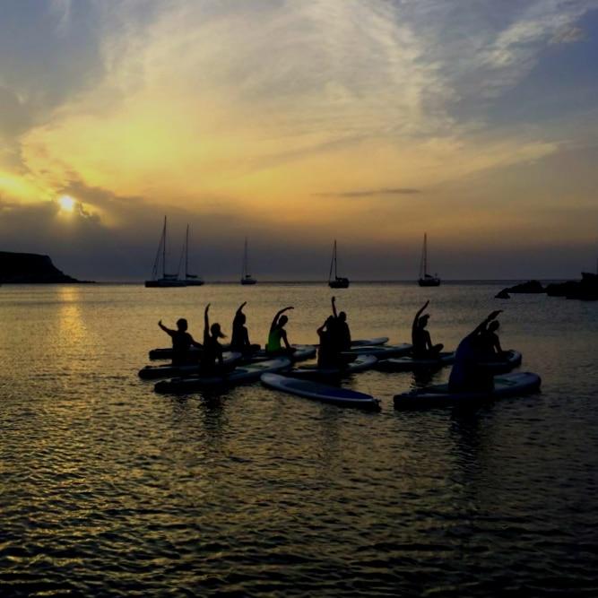 SUP yoga at sea