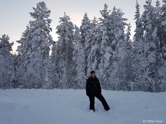 A warm winter outfit is essential in Finnish Lapland in December
