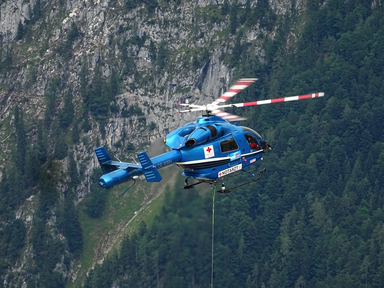 Ambulance helicopter in the mountains