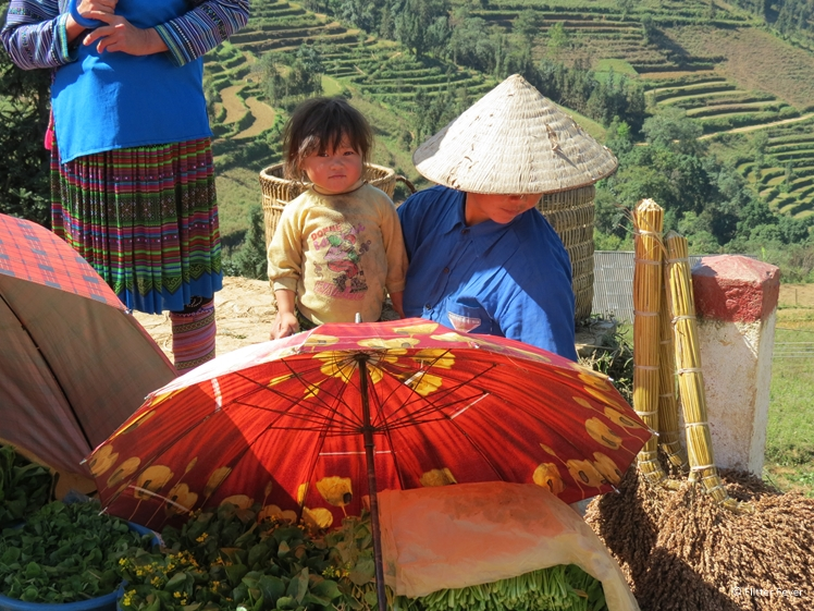 Little girl with parent at Can Cao Market near Sapa, North Vietnam