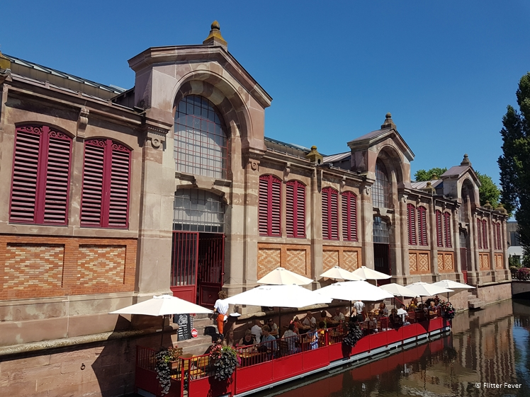 Halle du Marche Couvert market hall with terrace at canal in Colmar