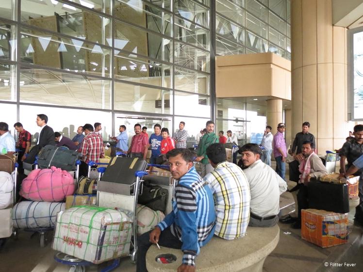 People waiting outside Riyadh International Airport