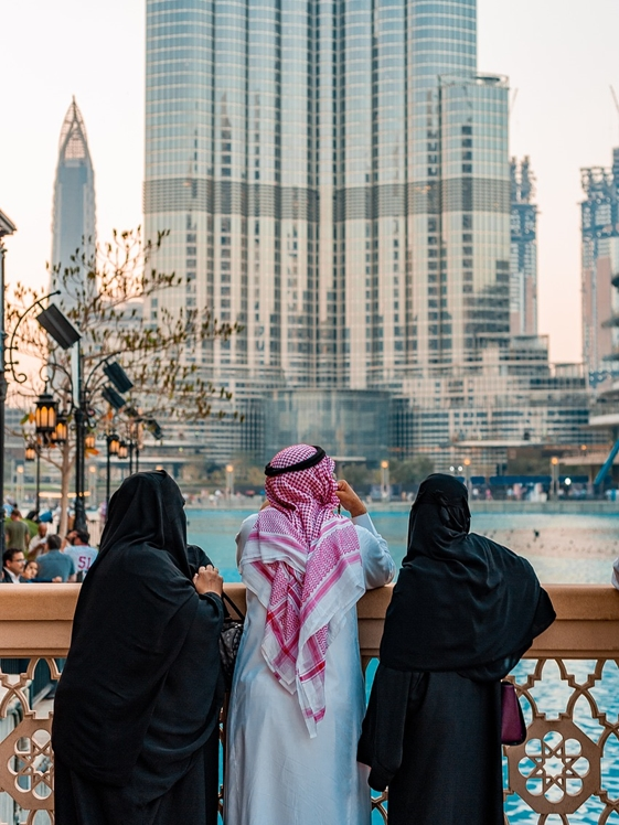 Arab man and women looking at Burj Khalifa
