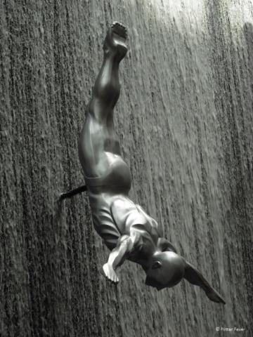 Statue of diving man at waterfall Dubai Mall
