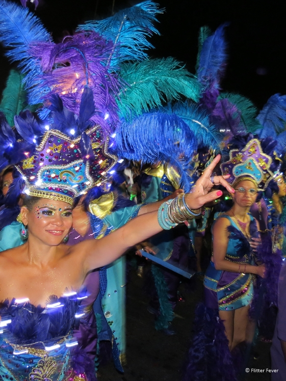 Party lady with blue purple turqoise feathers Carnaval Curacao