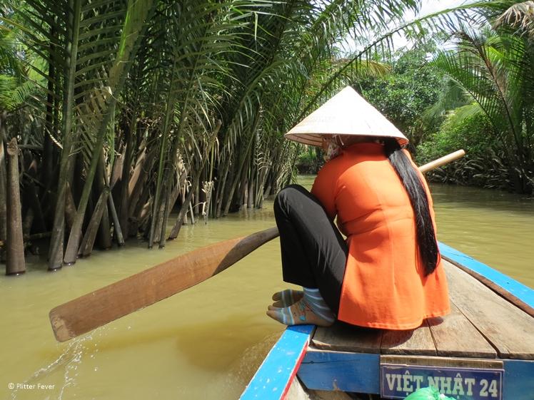 lady in boat Mekong Delta Vietnam route