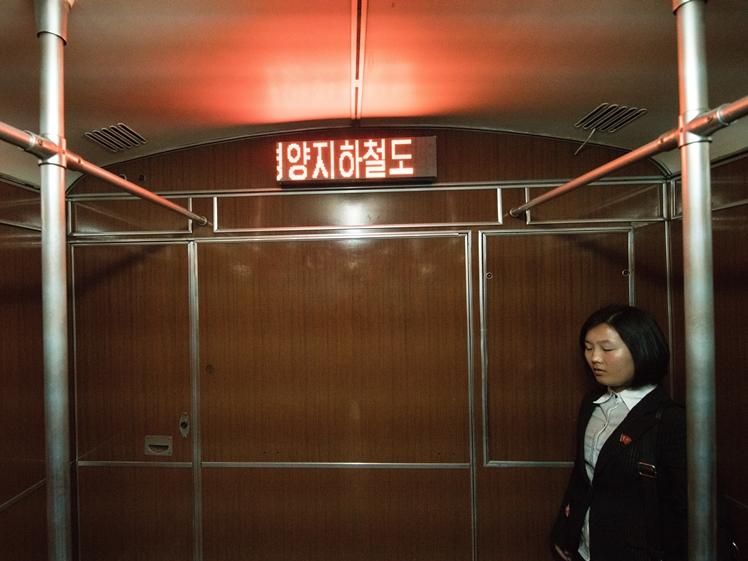 Korean girl in metro in Pyongyang North Korea