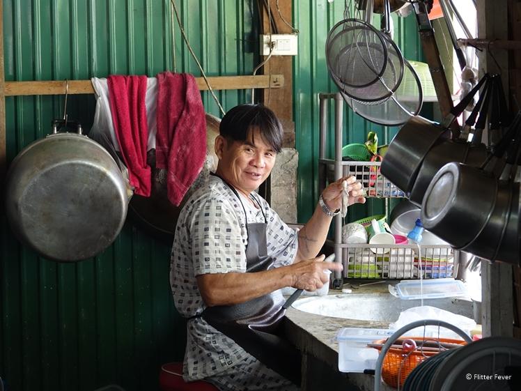Thai man preparing fresh fish in village on Koh Chang