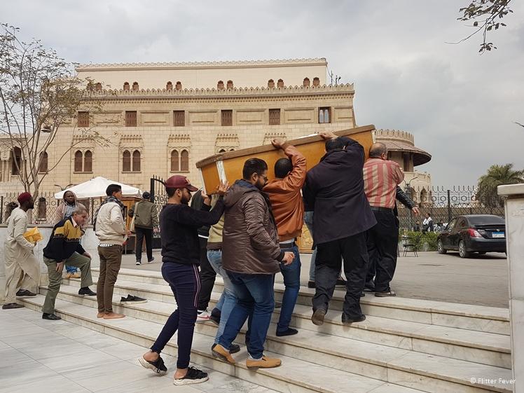 Egyptian men carrying a coffin outside the Al-Azhar Mosque Cairo