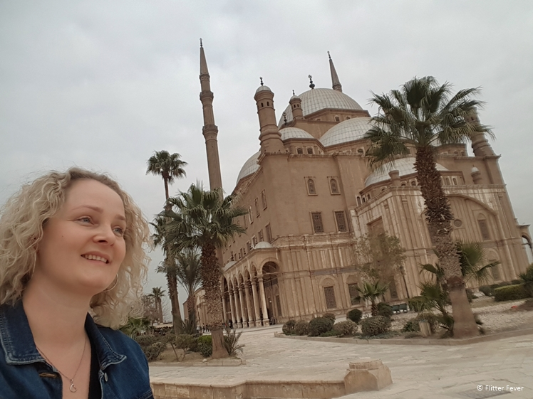 Woman standing in front of the Mohammed Ali Mosque inside the Citadel in Cairo