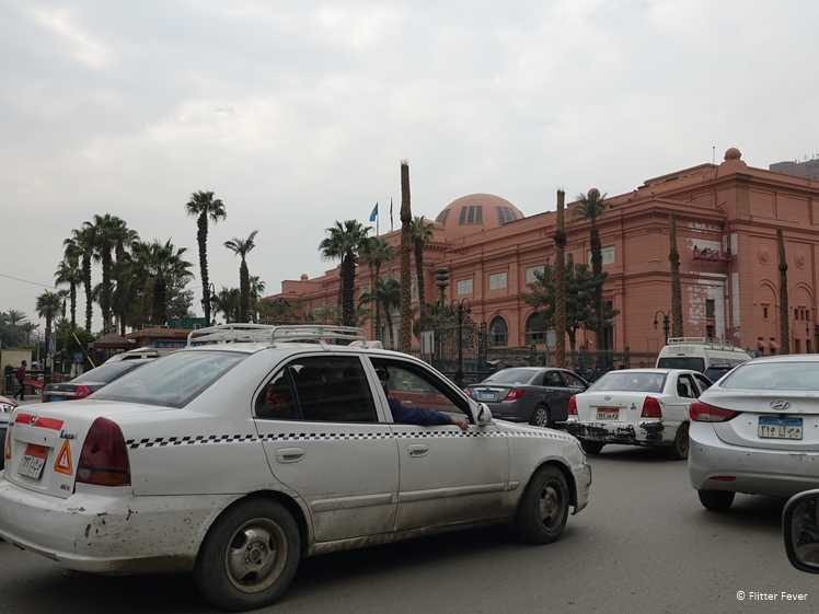 Taxis and the Egyptian Museum seen from Tahir Square