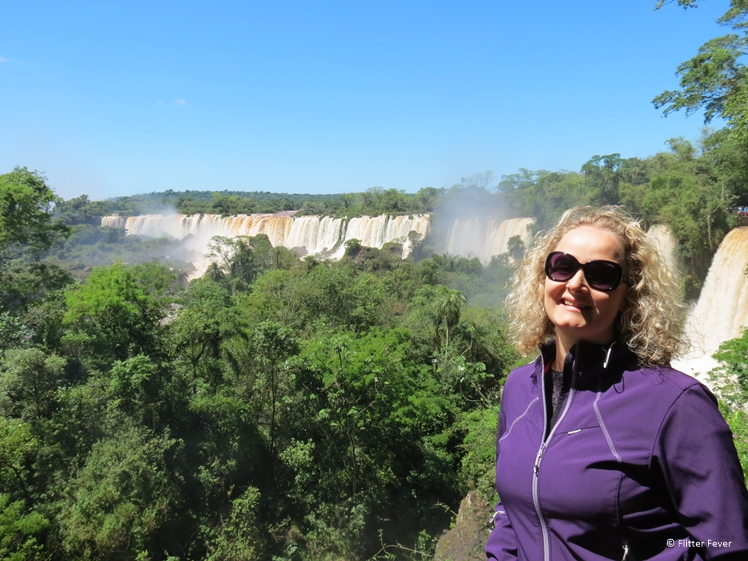 Happy woman at Iguazu Falls Argentina on a sunny day